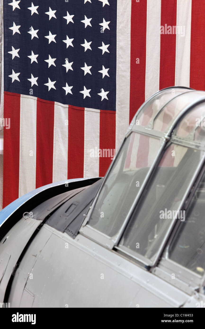 vintage T-6 aircraft cockpit and U S flag - Stock Image