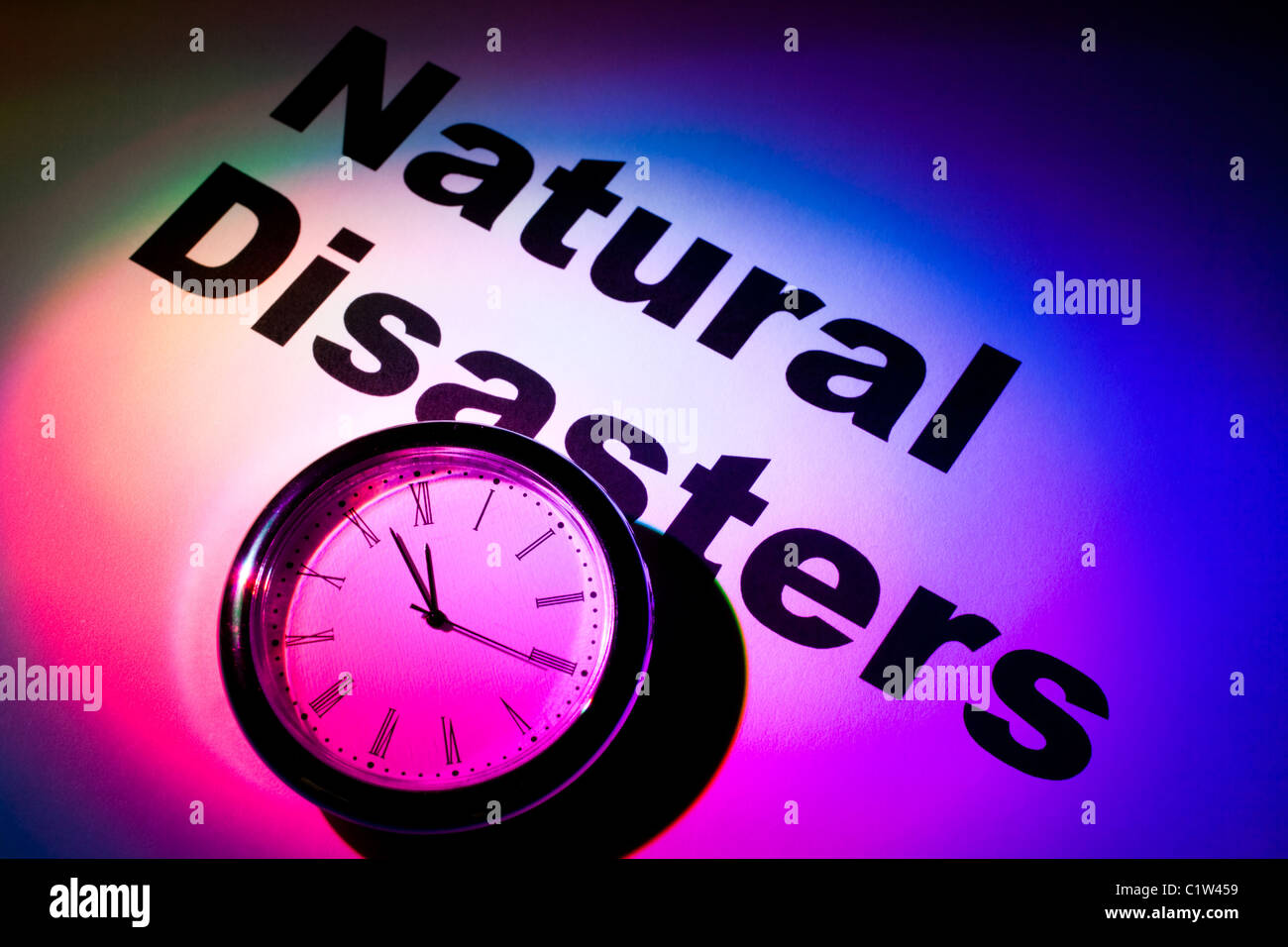 Clock and word of Natural Disasters for background - Stock Image