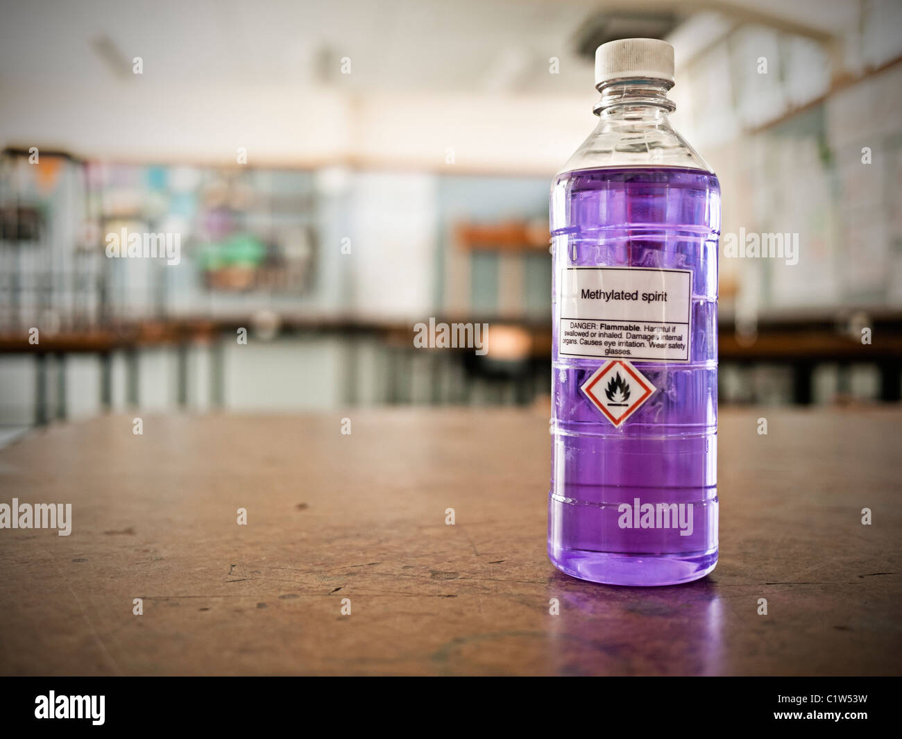 Methylated spirits bottle in school science laboratory. - Stock Image