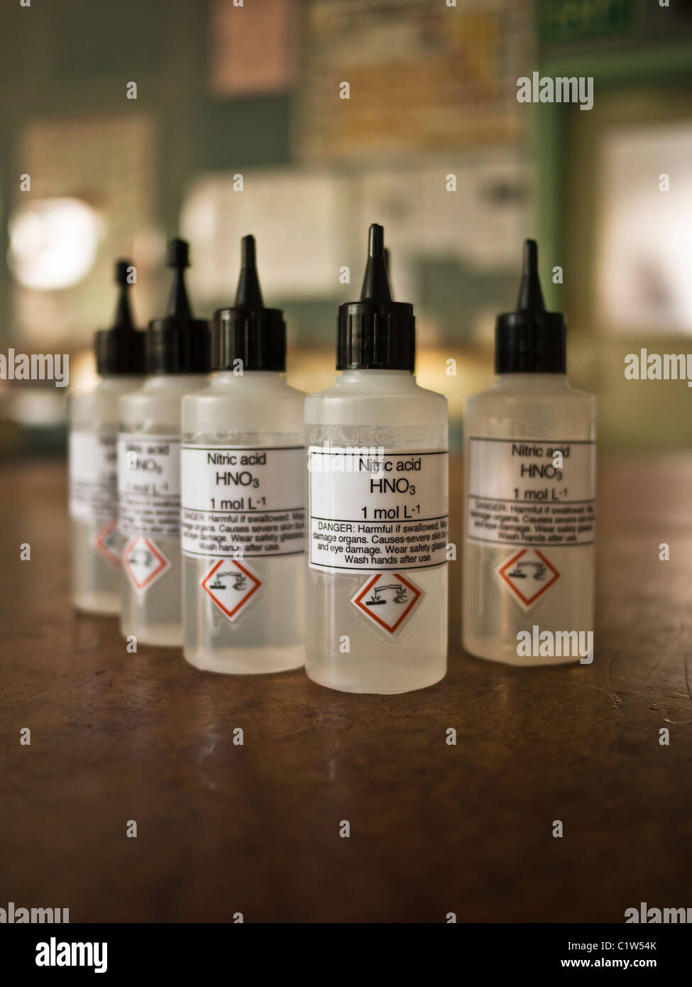 Nitric acid dropper bottles used in school science laboratory - Stock Image