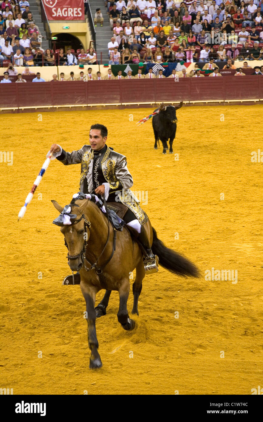 A skilled horseman (Cavaleiro) in action during a Portuguese style bullfight at the Campo Pequeno in Lisbon, Portugal. - Stock Image