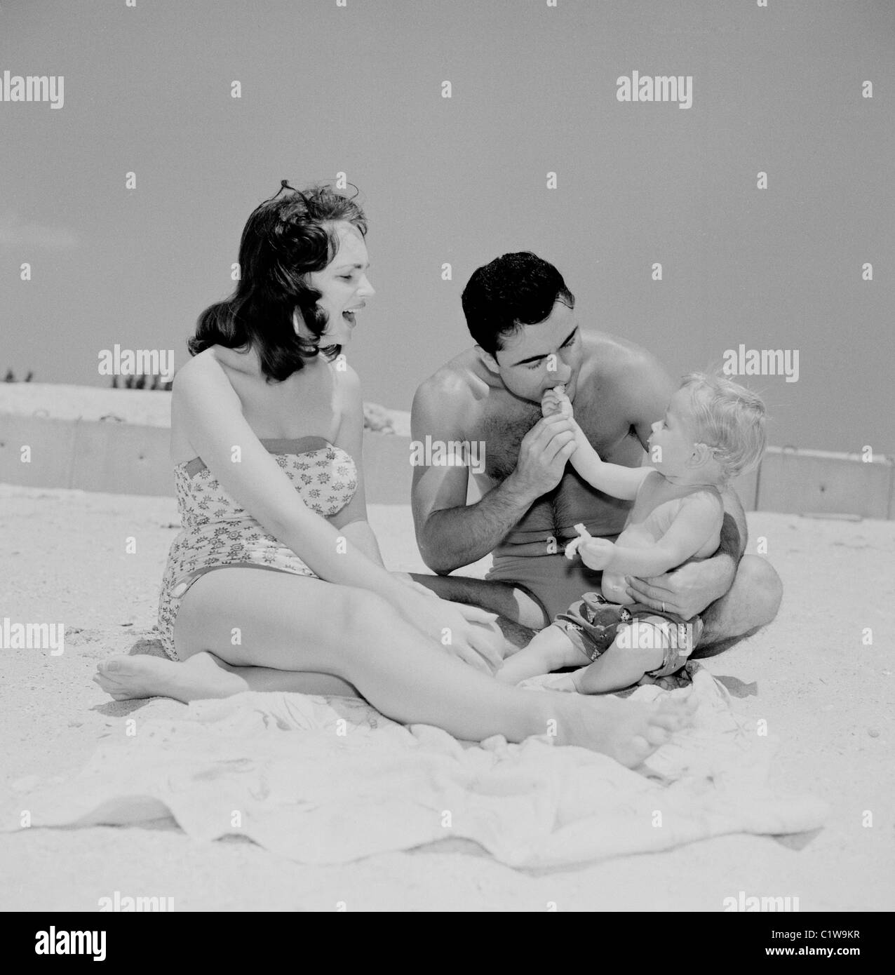 Family with baby boy on beach - Stock Image