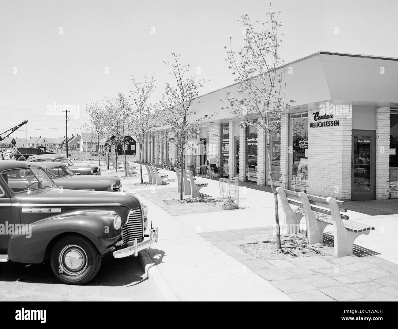 Cars parked outside shop - Stock Image