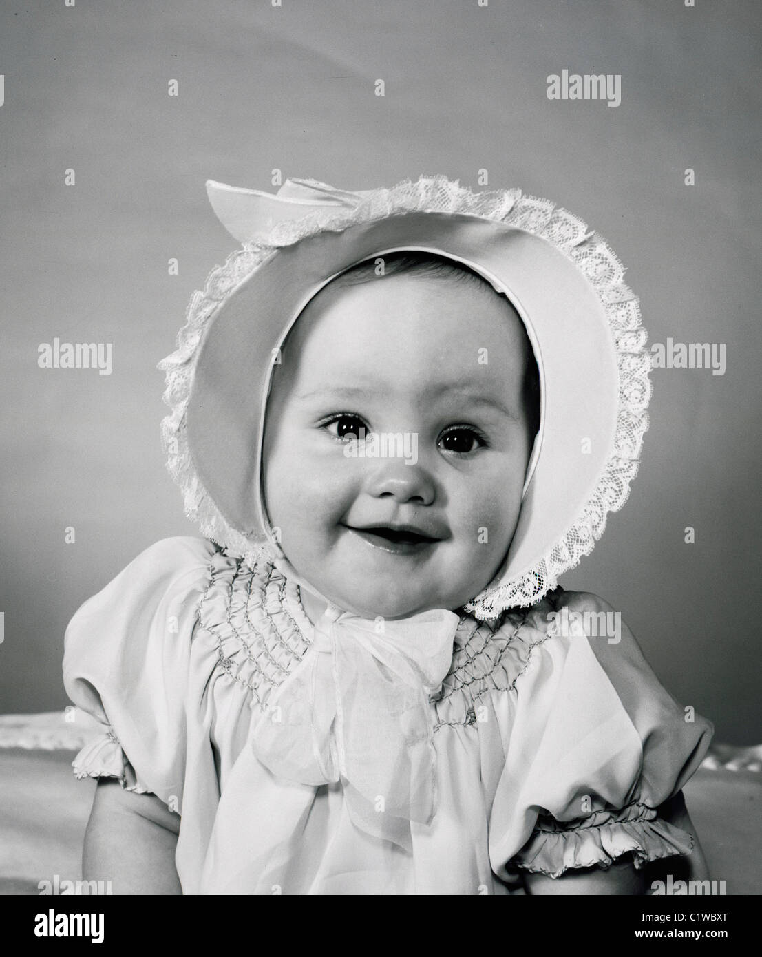 Portrait of baby wearing bonnet Stock Photo  35593568 - Alamy cf7369e67da