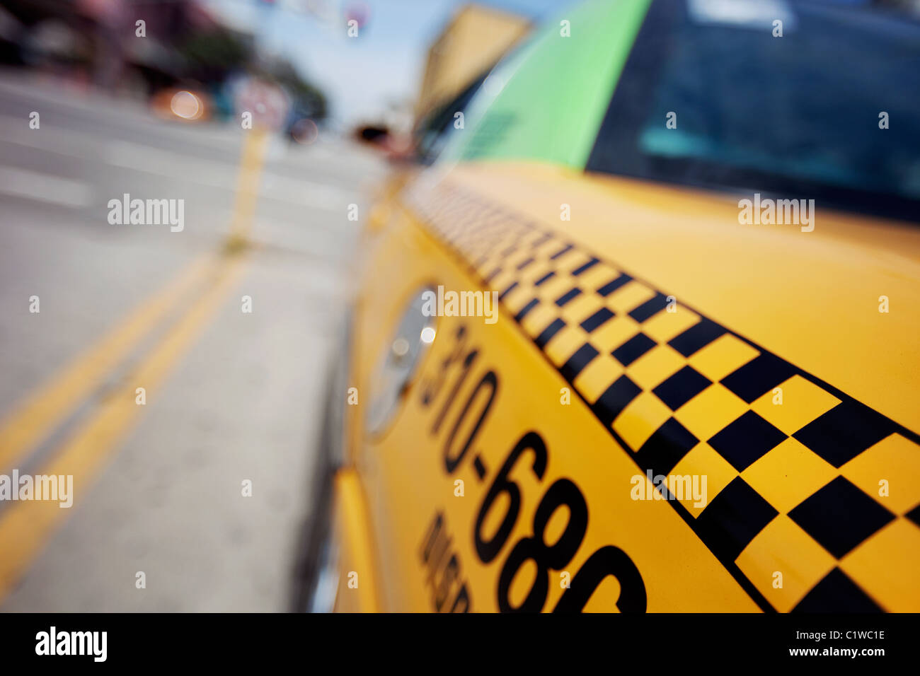 Close-up of a checkered taxi cab shot from the rear in Santa Monica, CA - Stock Image