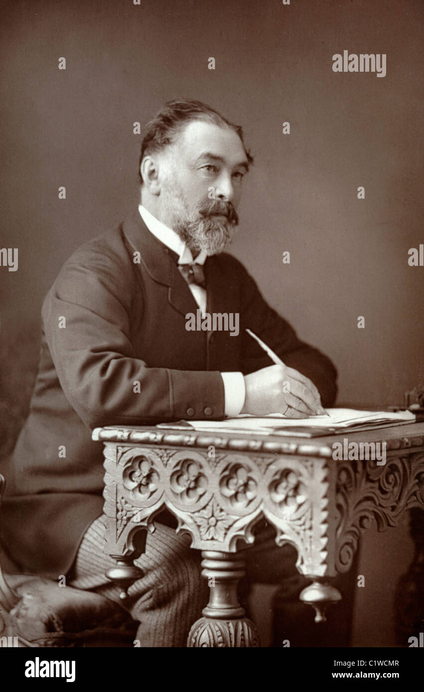 Portrait of Frederic Harrison (1831-1923) British Jurist & Historian Writing on Ornate Carved Arts and Crafts - Stock Image