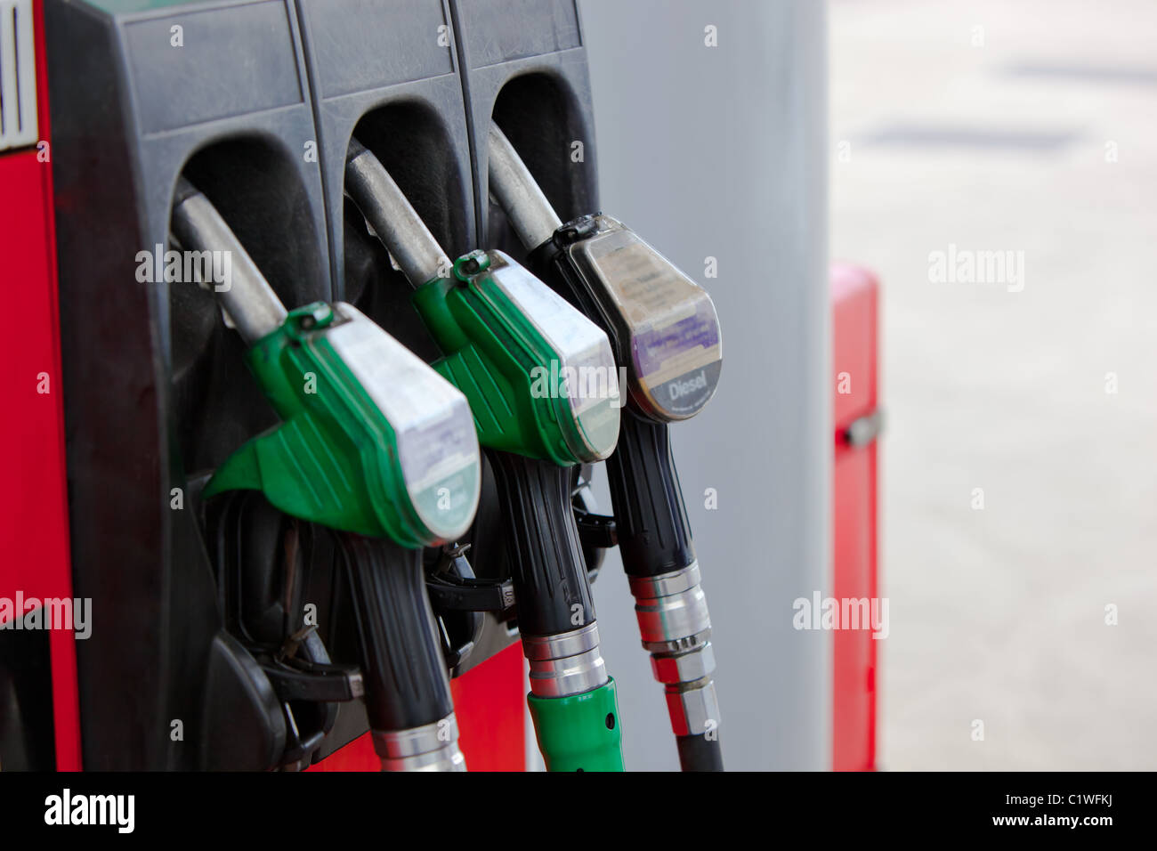 Close-up of a gasoline pumps nozzles in a petrol station Stock Photo