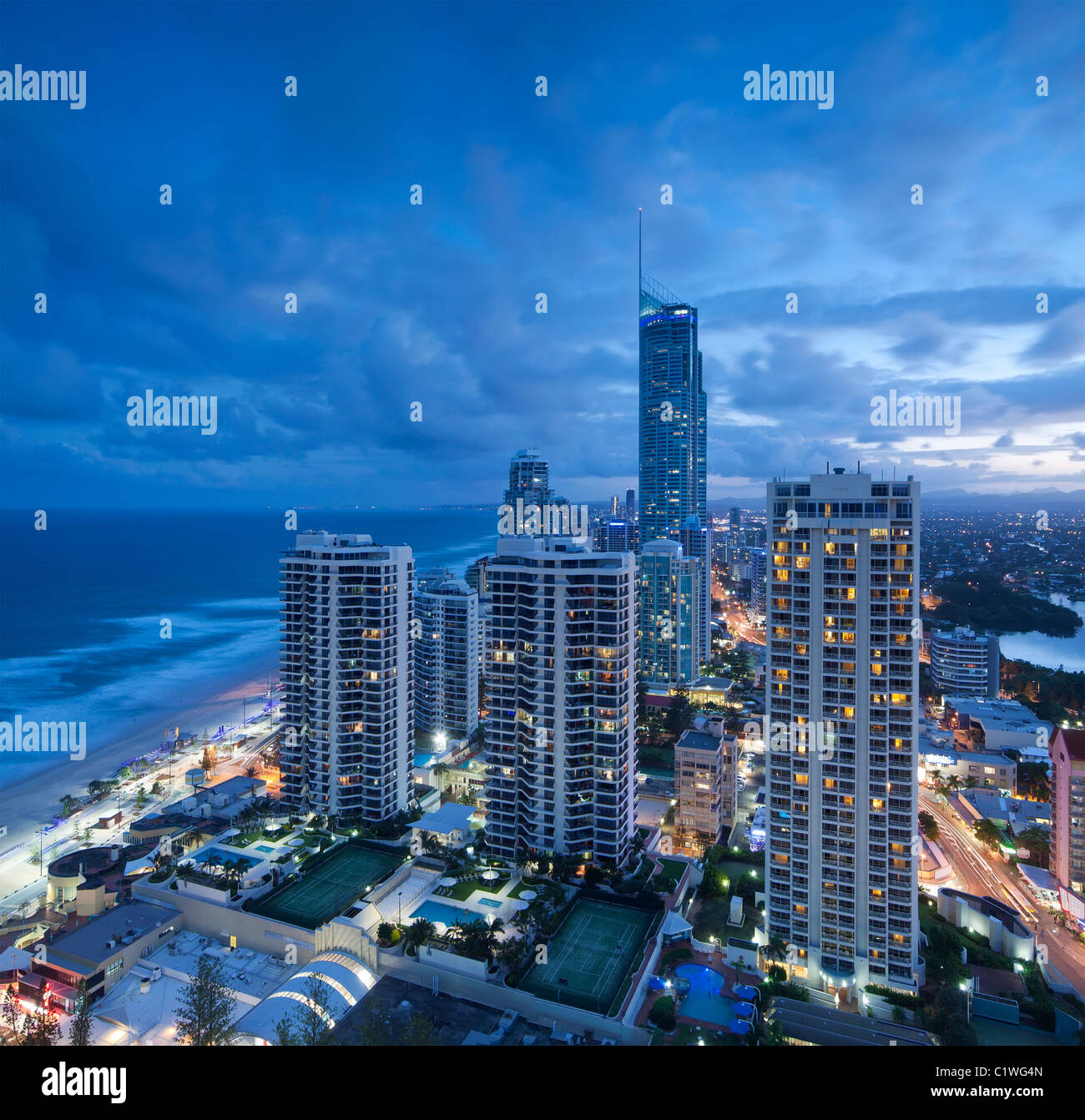 View over the modern city at dusk with ocean beside on square format (gold coast,queensland,australia) - Stock Image