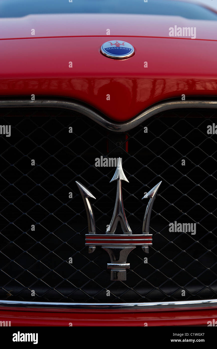 MASERATI SPORTS CAR BADGE AND RADIATOR GRILL - Stock Image