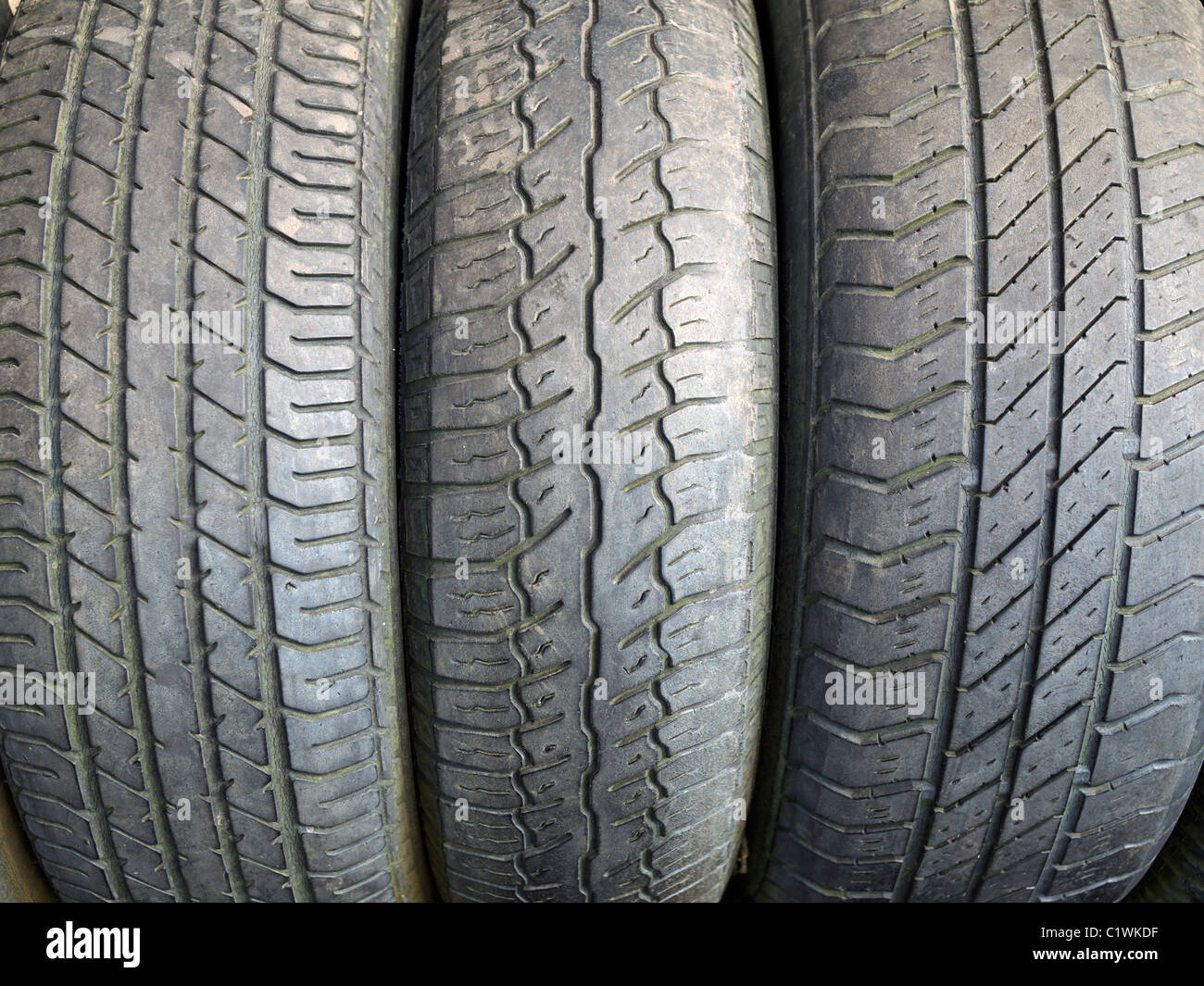 Worn car tyres in a row at the Eden project St Austell Cornwall UK - Stock Image