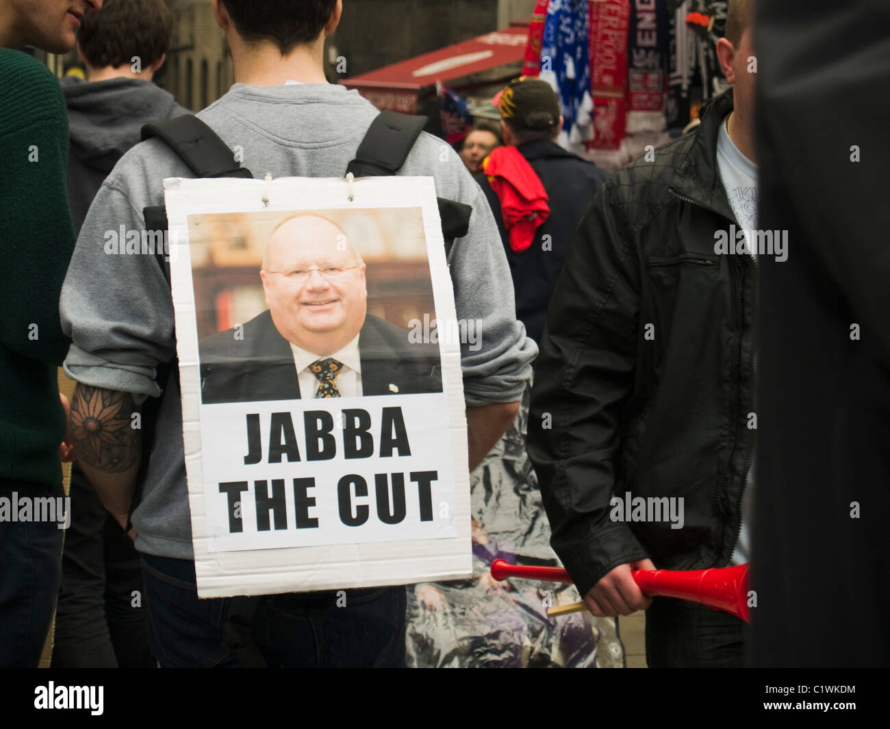 A placard mocking the Secretary of State for Communities Eric Pickles during a demonstration against Government - Stock Image