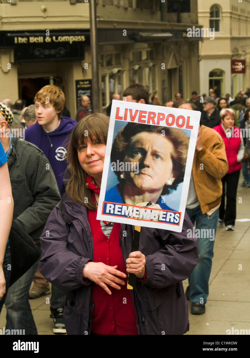 Protester taking part in a demonstration against Government cuts in London. - Stock Image