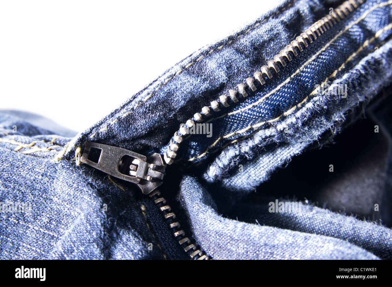 A close up of a zipper on a pair of jeans. - Stock Image