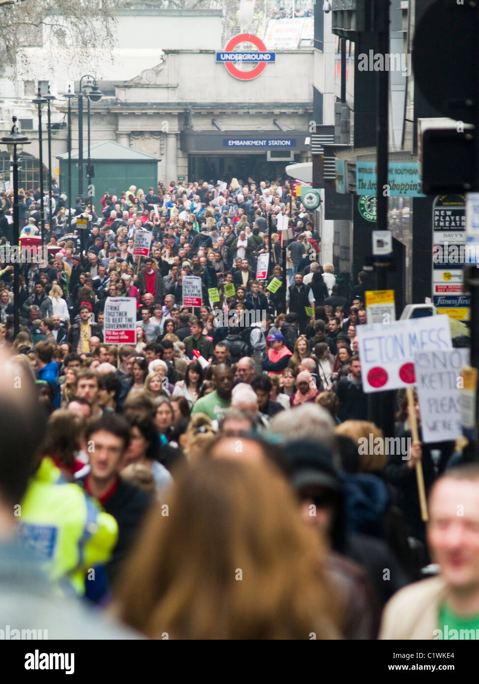Protesters waling up Villiers Street as they take part in a demonstration against Government cuts in London. - Stock Image