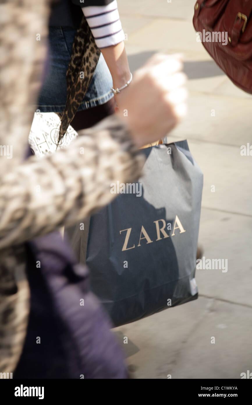 db11487c Girl carrying a Zara shopping bag in Oxford Street, London - Stock Image