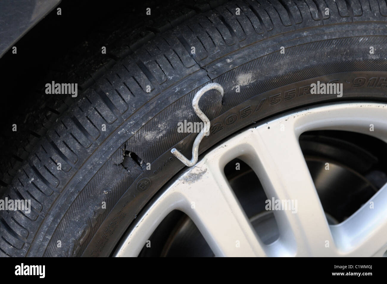Flat, punctured tire - Stock Image