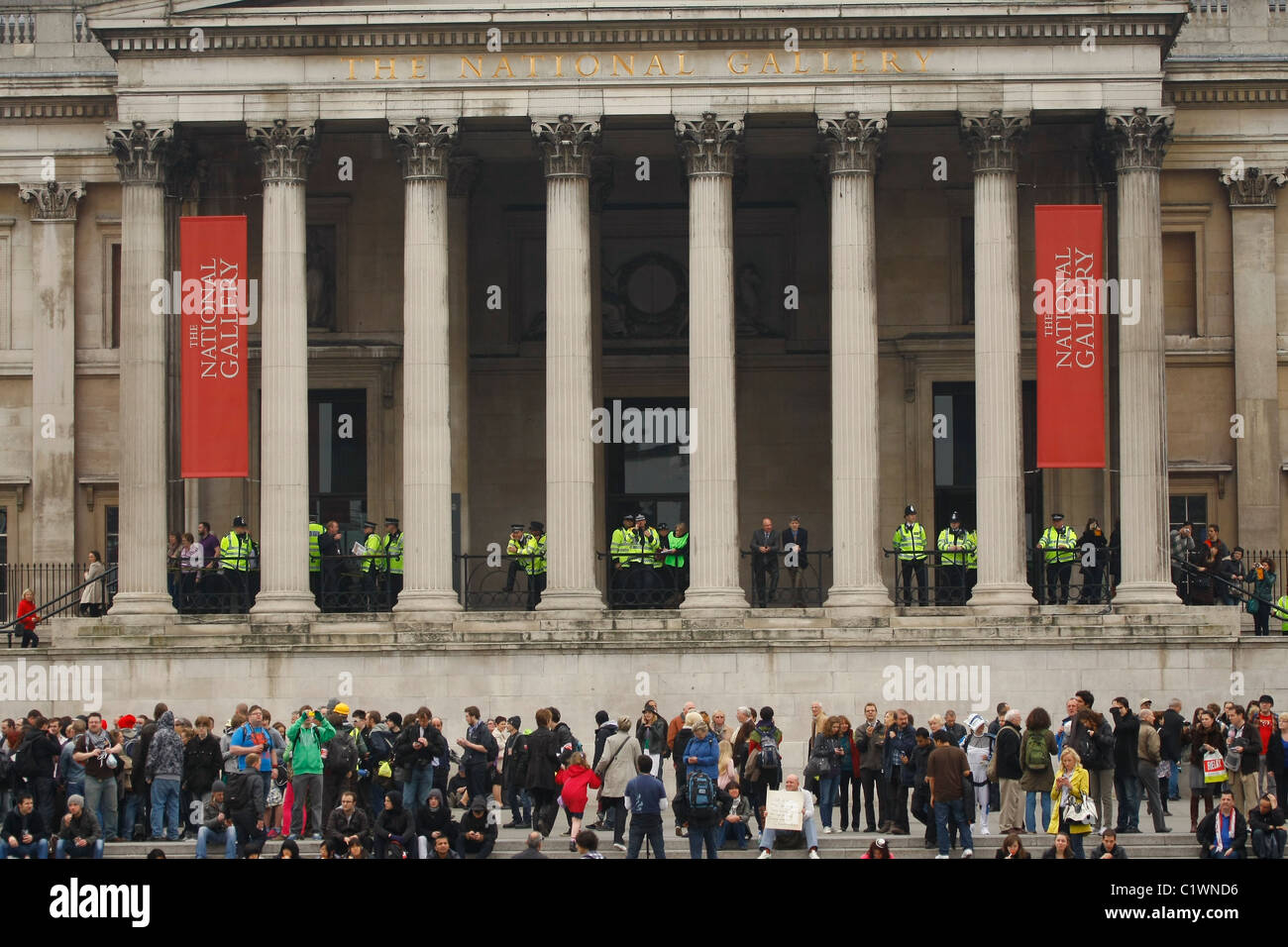 Police survey Trafalgar Square,London, SW1 as marchers on the  ' Alternative Way '  TUC March 26th March, - Stock Image