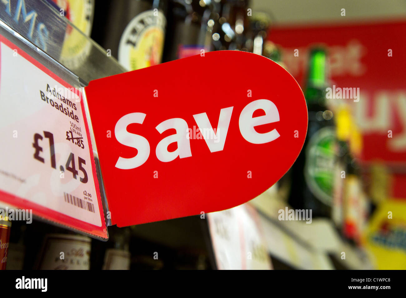 A save money sign in a uk supermarket - Stock Image