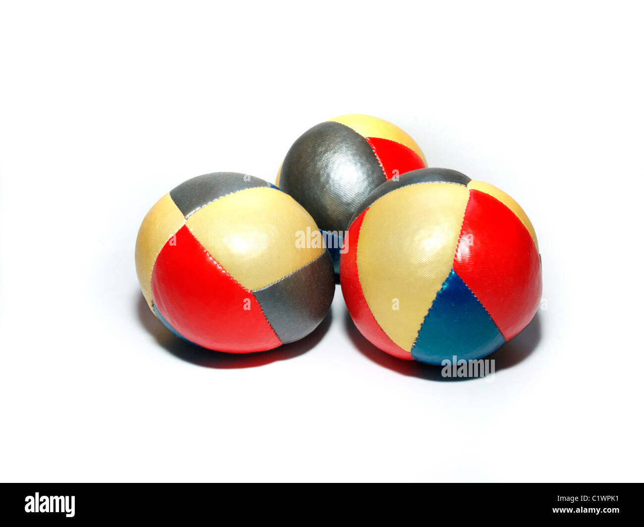 Juggling balls on white background - Stock Image