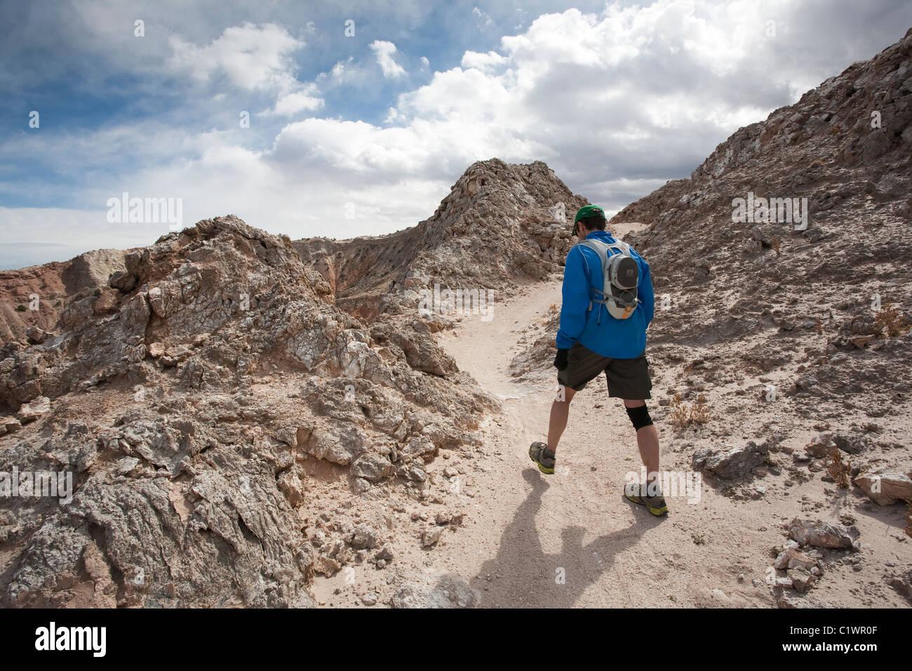 runner hiking along the white mesa bike trails area ojito stock