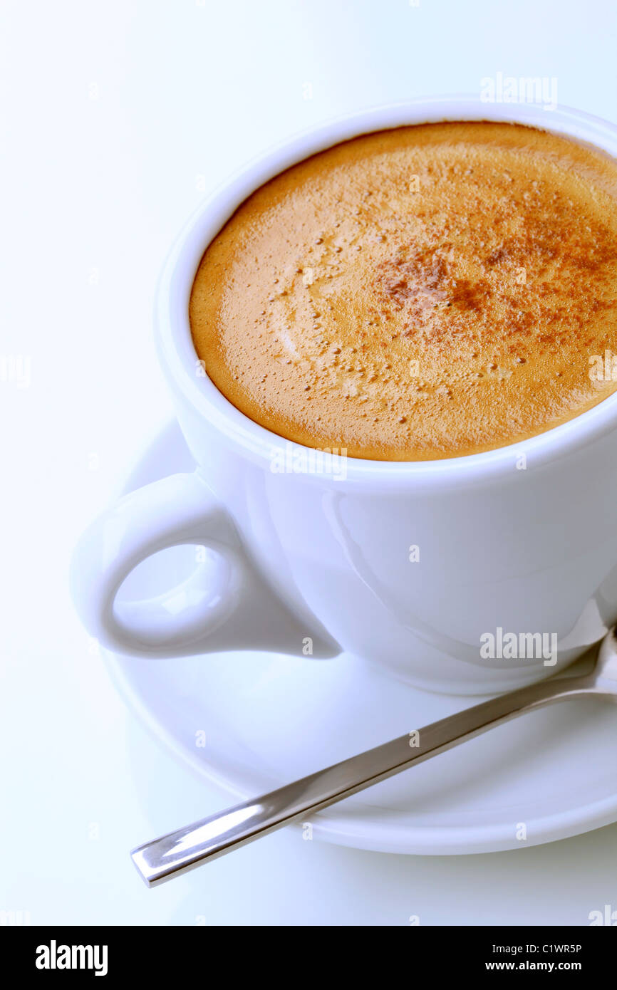 Cup of coffee with froth and a dusting of nutmeg - Stock Image