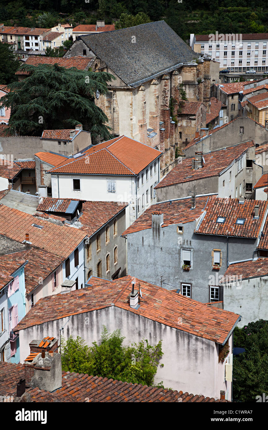 Church and houses with red tile roofs Foix department Ariege France - Stock Image
