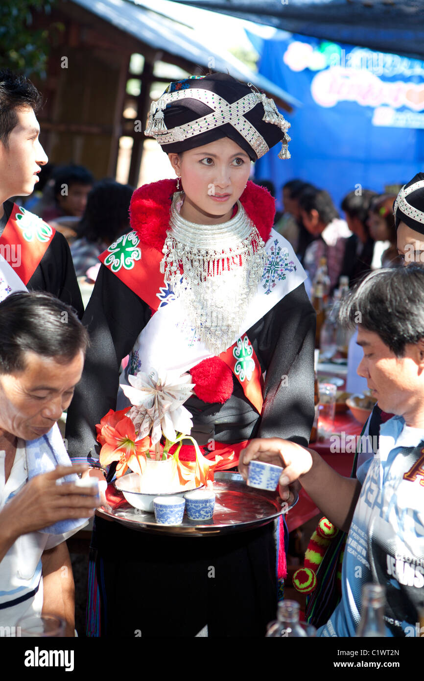 Iu Mien(Yao) bride offering toast to alcohol to guest and receive donation, Ban Bur Siliam, Pongta, Ngao, Lampang, - Stock Image