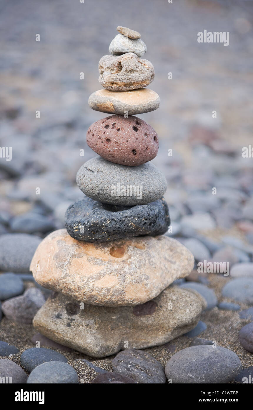 stack of wellness stones on the beach - Stock Image