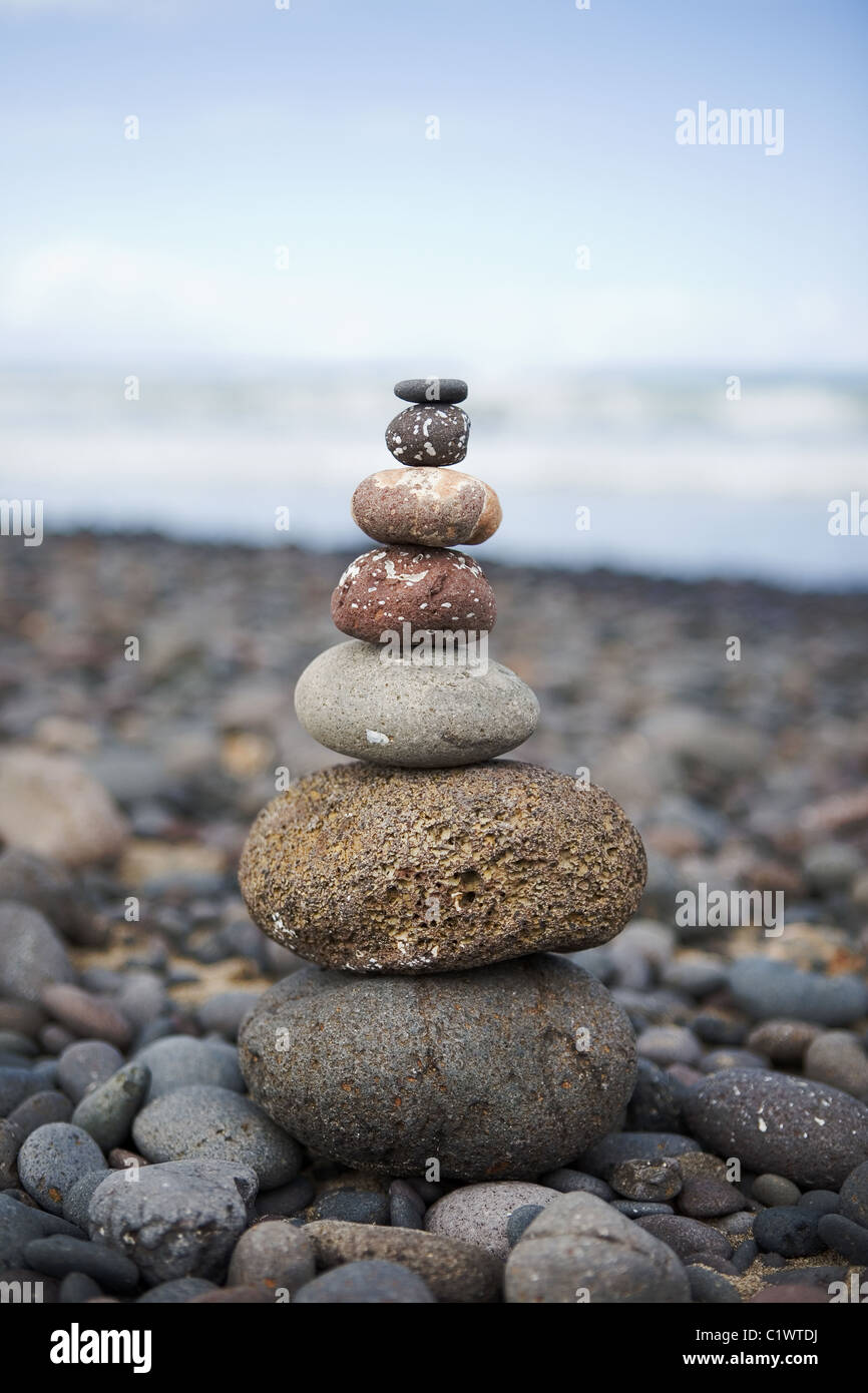 stack of stones on the beach - Stock Image