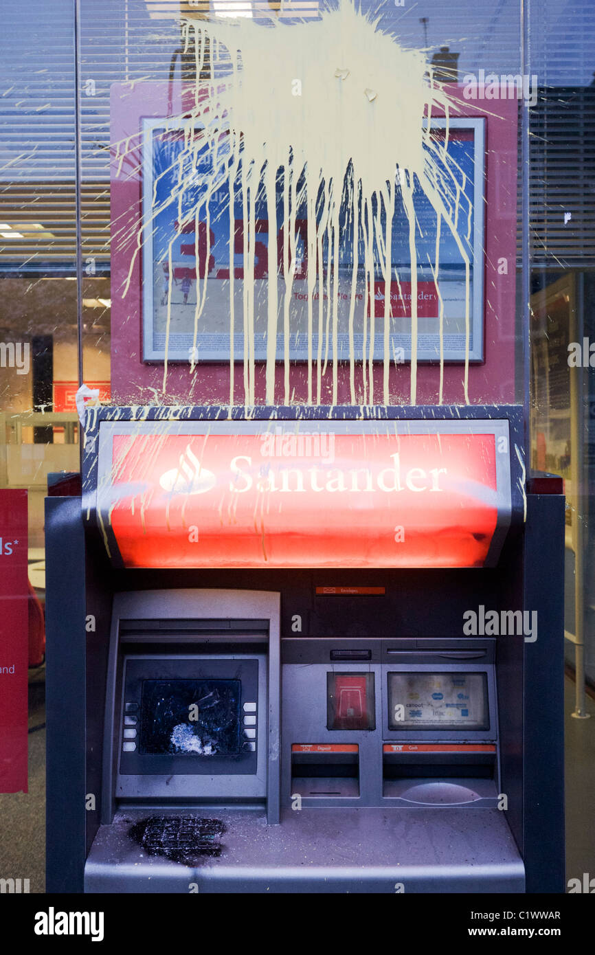 Vandalism to Santander bank property the morning after TUC-organised march against anti-government cuts to Britain's - Stock Image