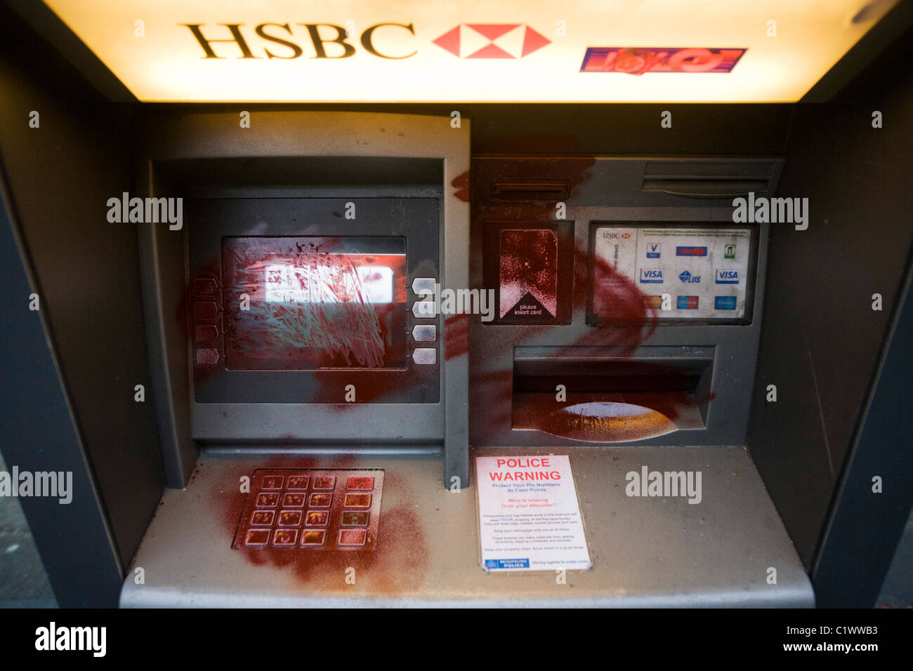 Vandalism to HSBC bank dispenser the morning after the TUC-organised march against anti-government cuts to Britain's - Stock Image