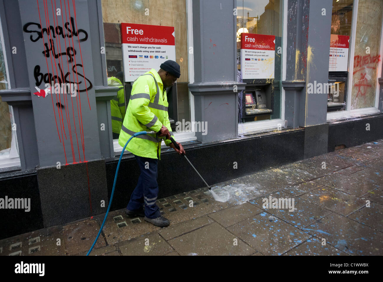 Cleaning up street the morning after the TUC-organised anti-government march against cuts to Britain's economy. - Stock Image