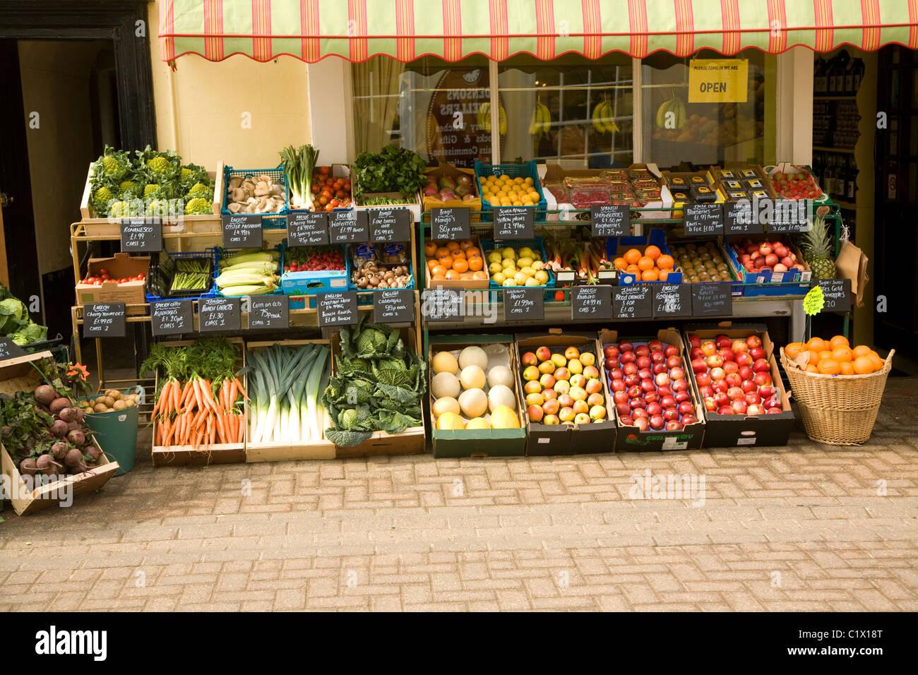 Display fruit vegetables outside greengrocers shop Halesworth Suffolk - Stock Image