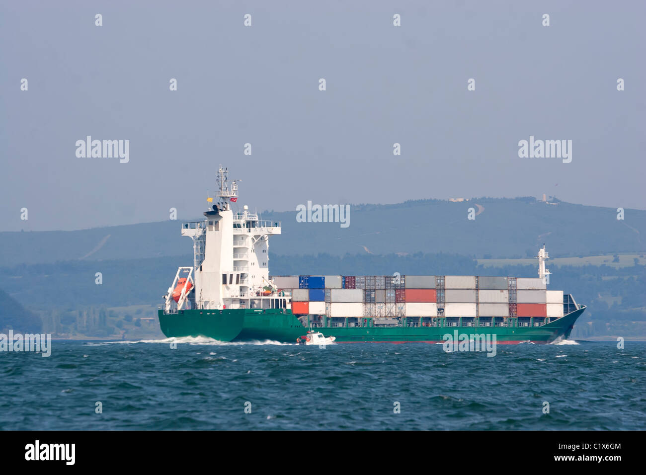 Container ship sailing to the port - Stock Image