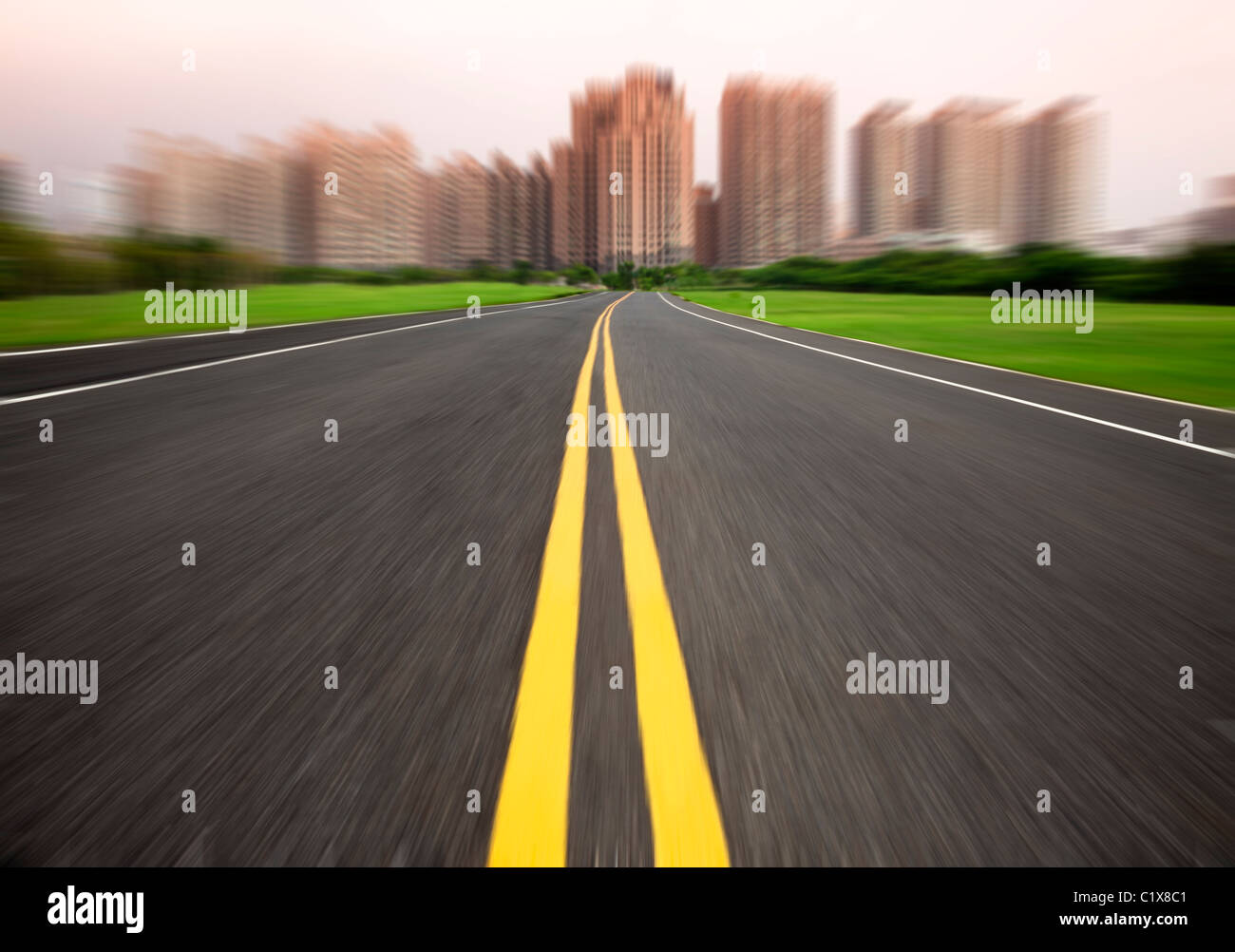 the road to city in motion blur - Stock Image