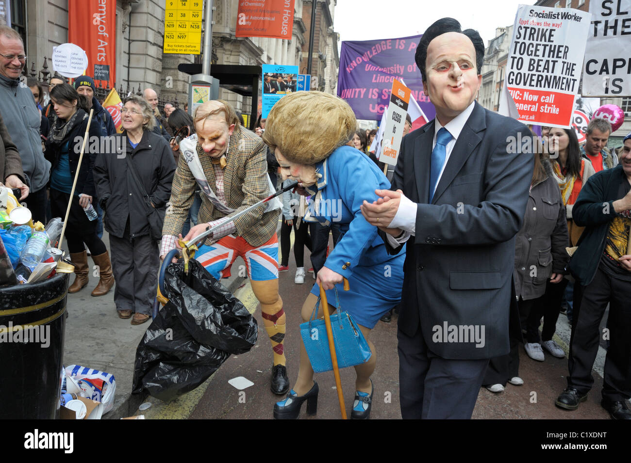Margaret Thatcher (litter picking) and David Cameron at TUC Anti-Spending Cuts March, London 26th March 2011 - Stock Image