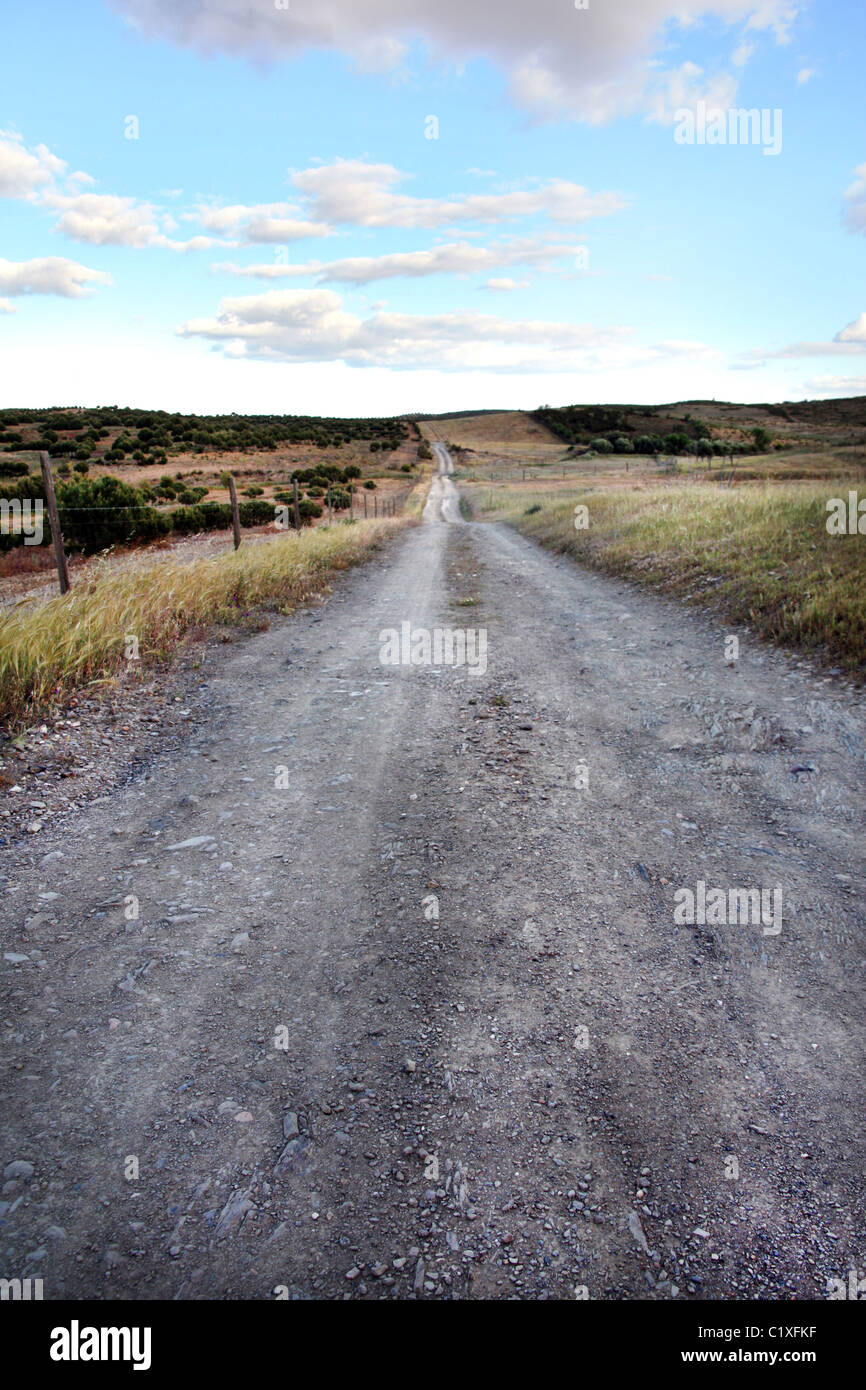 View of a dirt road on the countryside region of Algarve. - Stock Image