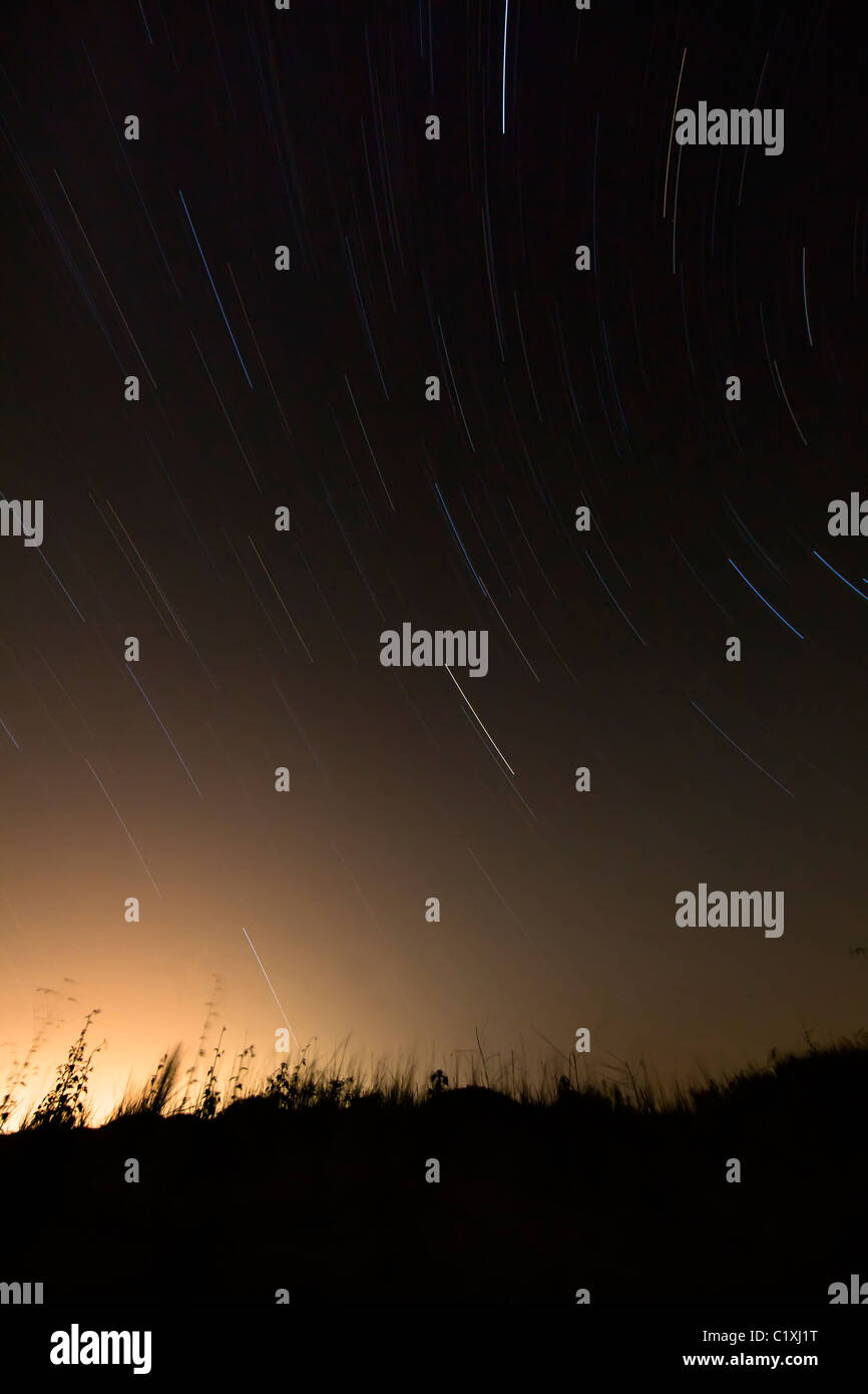 Star trails in night sky Texas USA - Stock Image