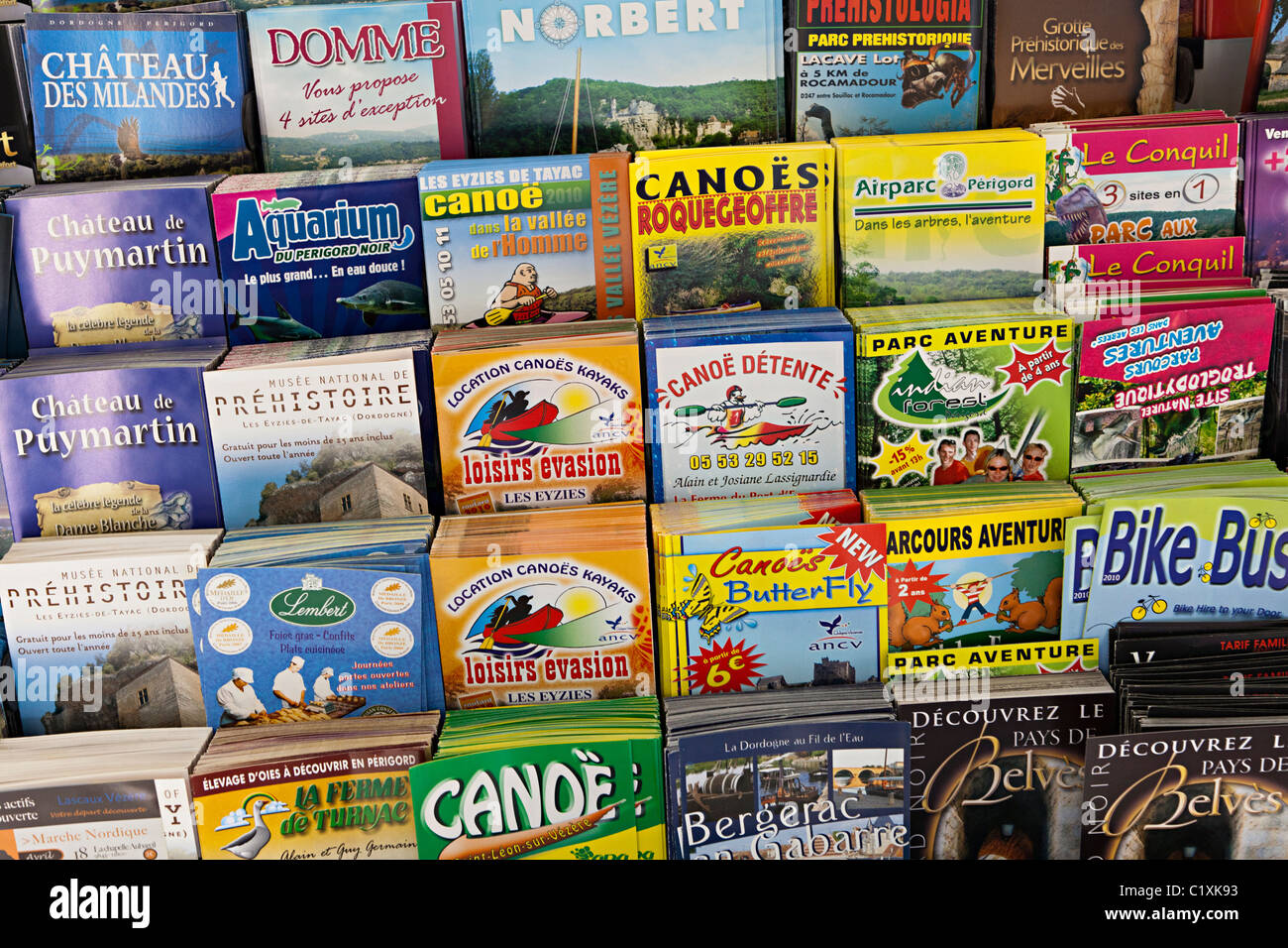 Advertising leaflets in tourist information office Montignac Dordogne France - Stock Image
