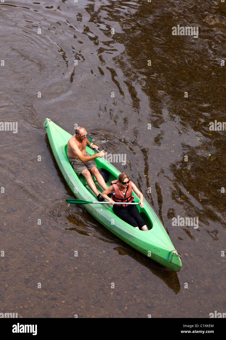 Two people in canoe on river Dordogne France Stock Photo