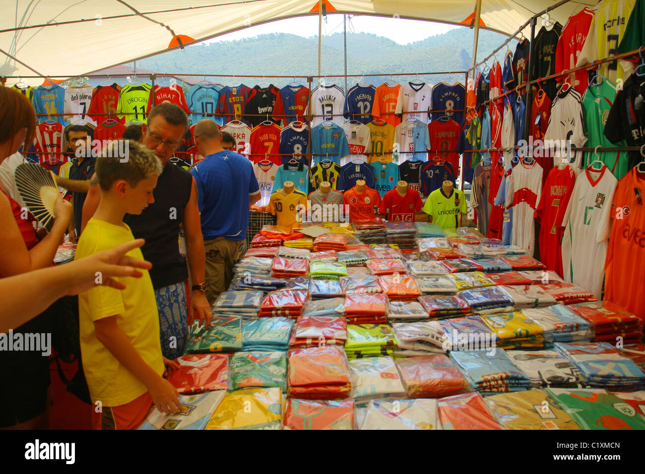 free shipping f79a0 b3306 Boy chooses a fake replica football kit in the local market ...