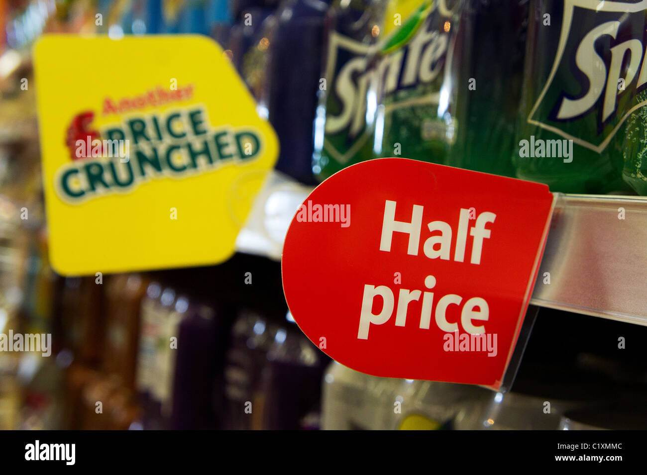 A ' half price ' ticket  in a uk supermarket - Stock Image