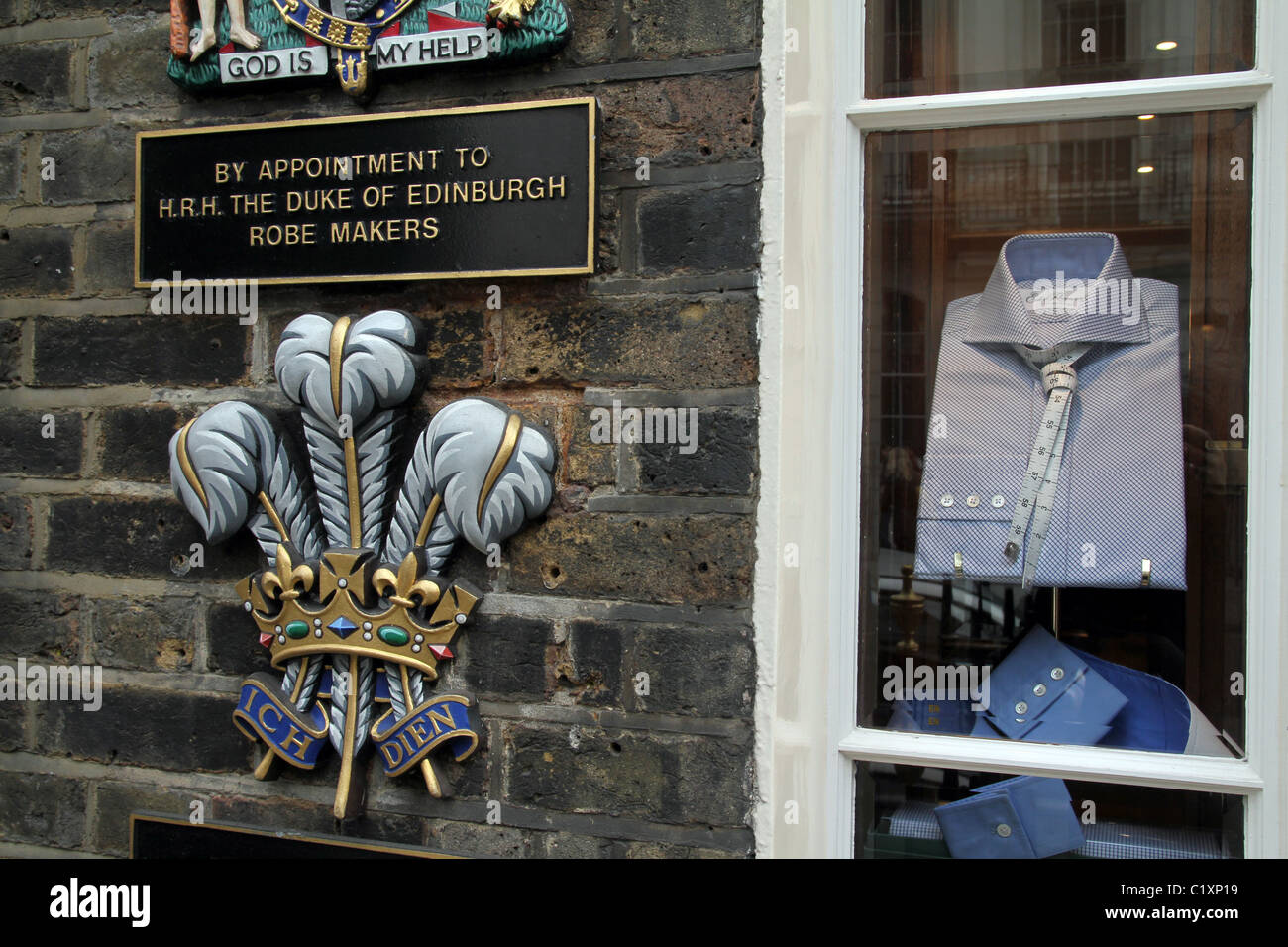 UK. Shirtmakers shop in Saville Row in London, with Royal appointment plaque on wall. - Stock Image