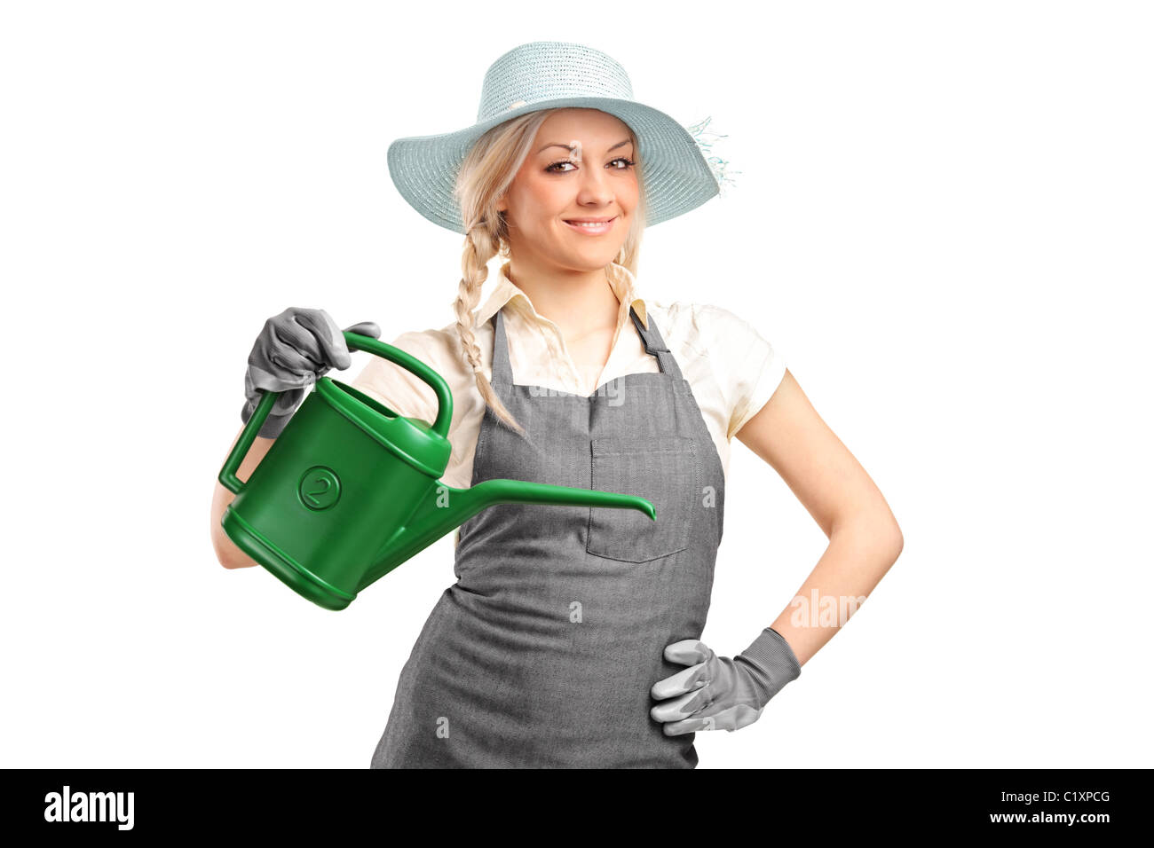 Portrait of a beautiful female gardener with watering can Stock Photo