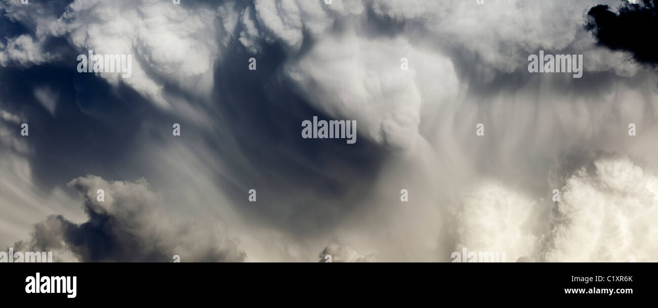 High-resolution panoramic image of a massive summer cumulonimbus cloud in dramatic late afternoon light over the - Stock Image
