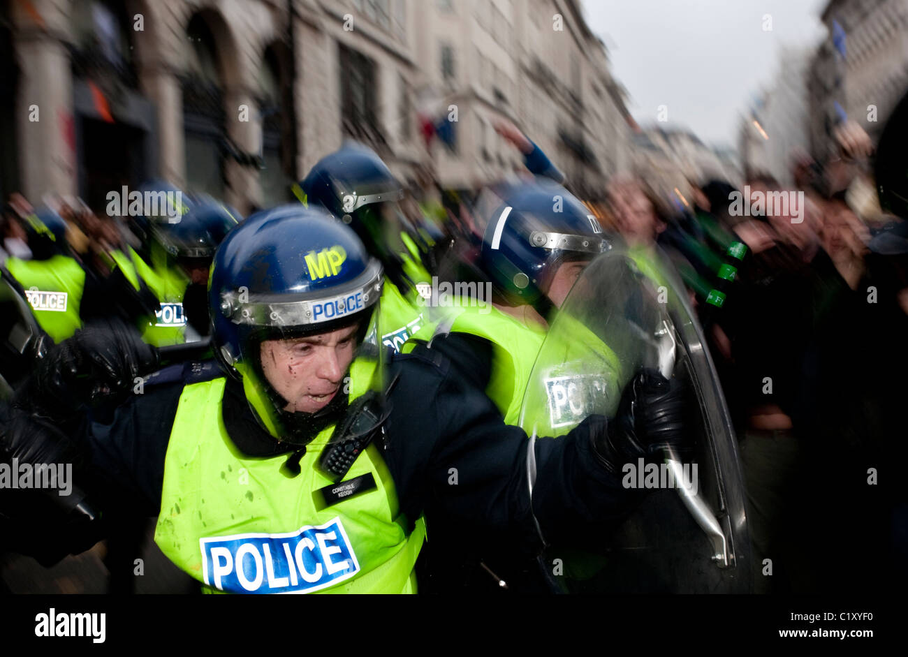 Anti-Cuts march 26/03/2011, London, UK Riot Police clash with demonstrators on Piccadilly during violent protests. - Stock Image