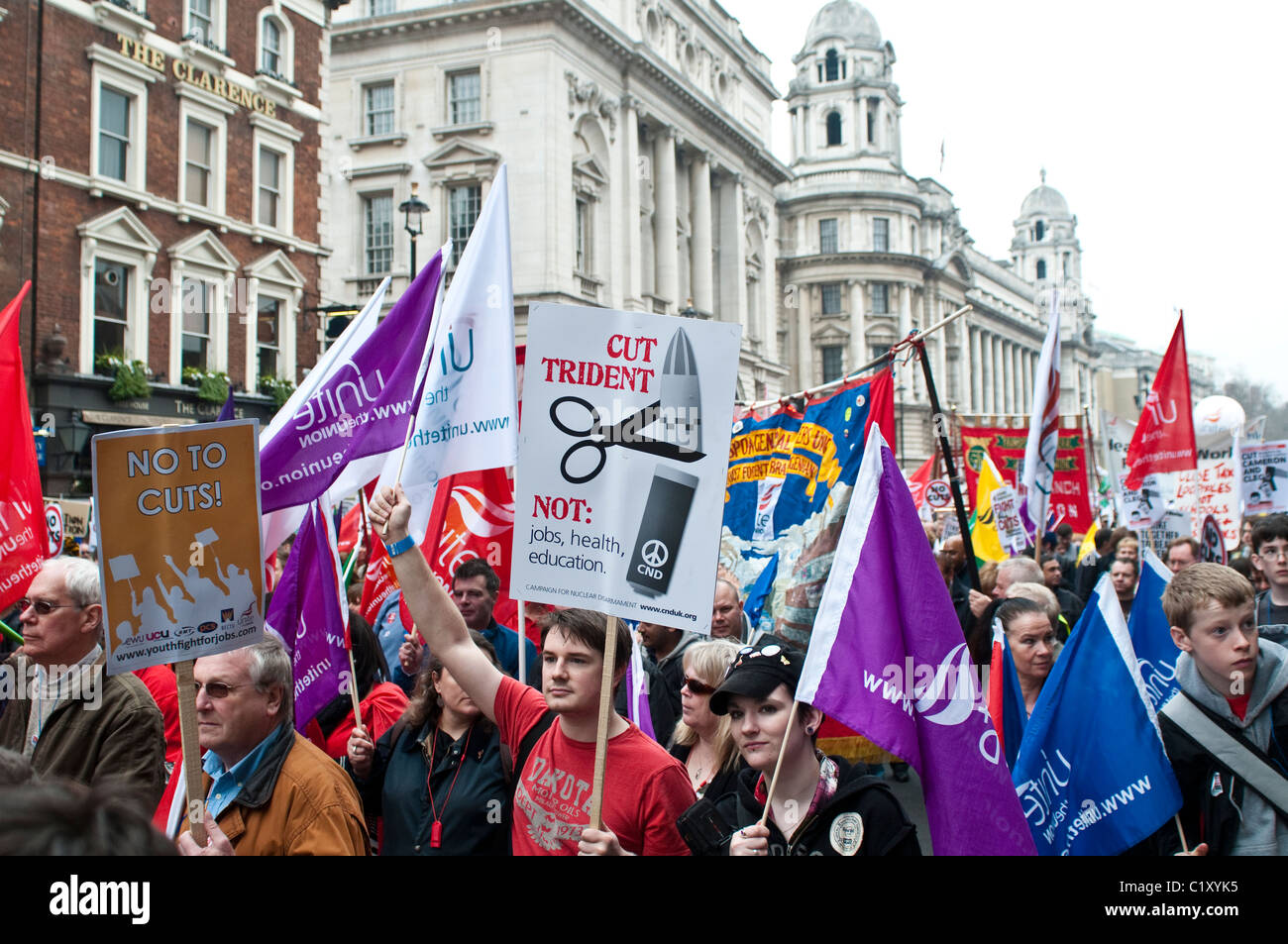 Protesters march down Whitehall. Placard 'Cut Trident', TUC March for the Alternative, London, UK, 26/03/2011 - Stock Image
