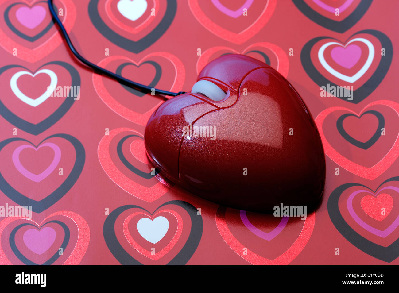 Heart shaped computer mouse - Stock Image