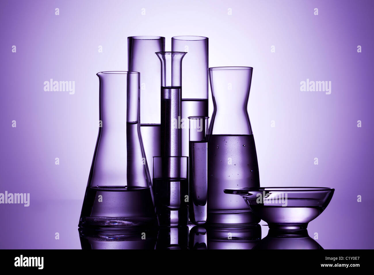 laboratory glassware, backlit, purple light - Stock Image