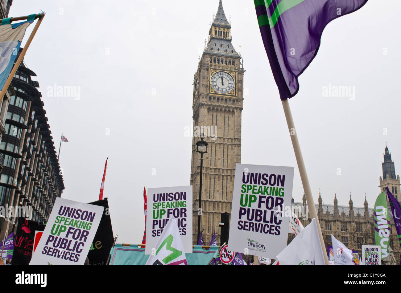Unison Public Services union banners Parliament BIg Ben TUC march against Coalition Government Cuts 26th March 2011 - Stock Image